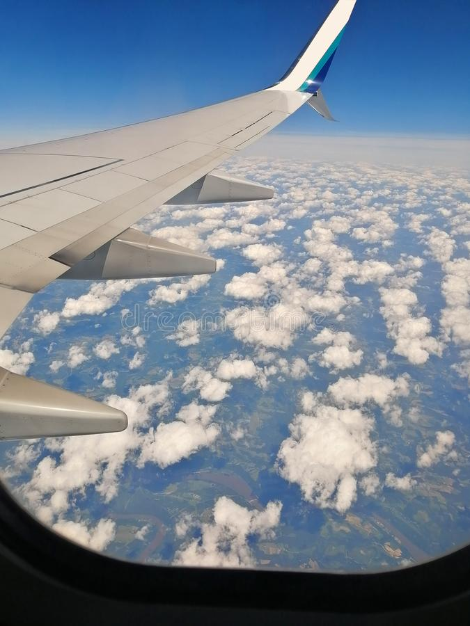 Airplane above clouds stock photo