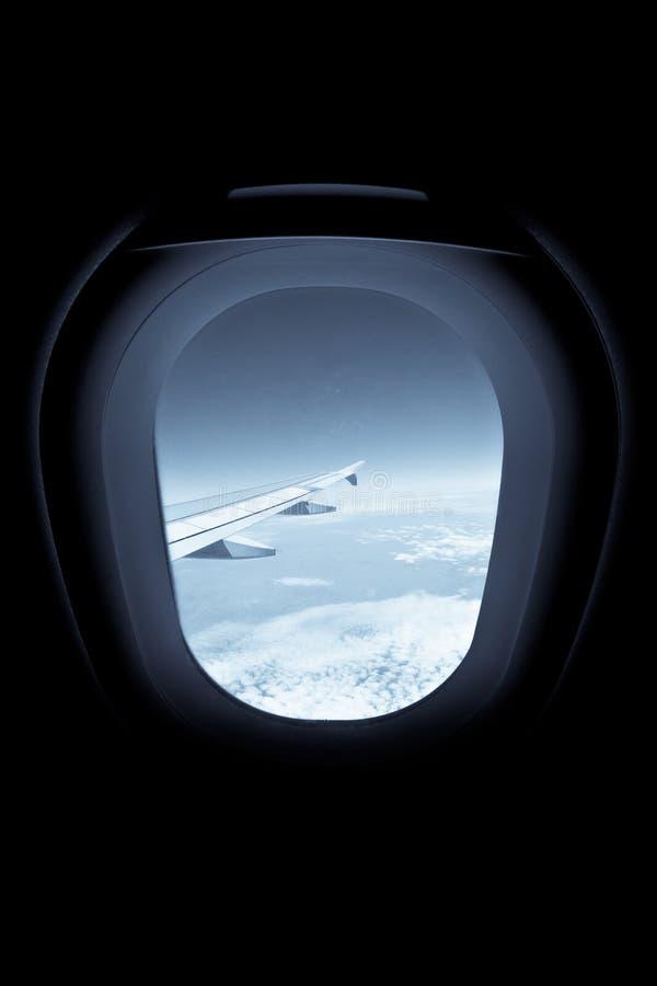 View through the airplane window. Dark, business travel, plane window, aircraft stock photography
