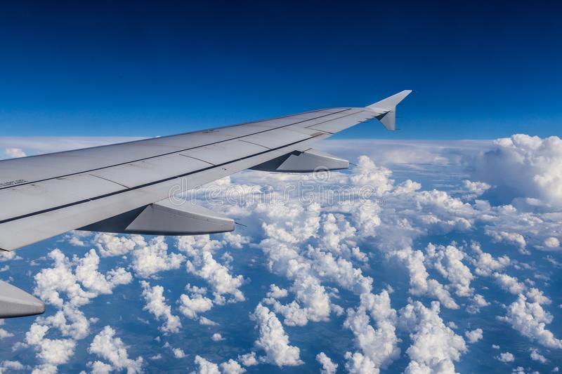 View from the airplane window, a lot of nice clouds royalty free stock images