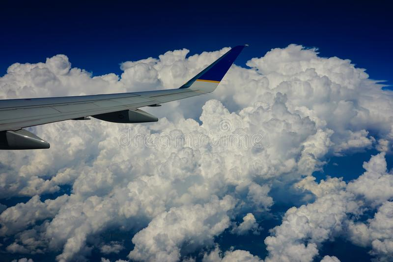 View from an airplane window to the clouds stock images