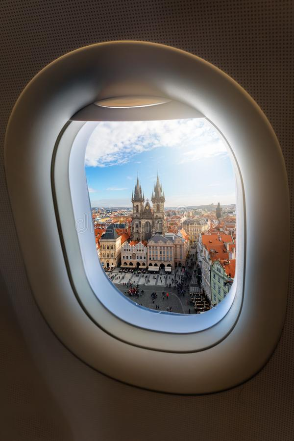 View from an airplane window to the old town and famous Tyn Church of the European city royalty free stock photo