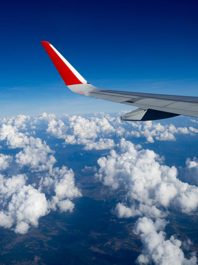 View from airplane windows from passenger, beautiful cloud group and blue sky. Wing aircraft in altitude during flight.Concept of. Travel and business trip royalty free stock photography