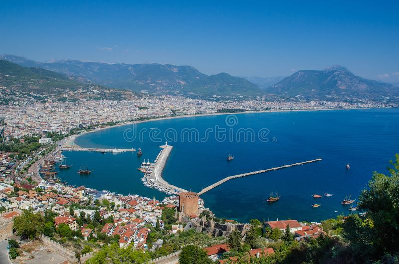 View of Alanya harbor before sunset. Beautiful sea landscape of Alanya Castle in Antalya district, Turkey. stock photos