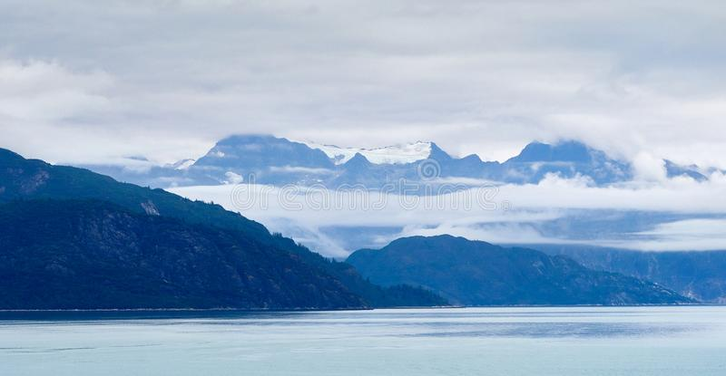 Alaskan skyline with mountains. A view of the Alaskan skyline with mountains seen from the sea stock photos