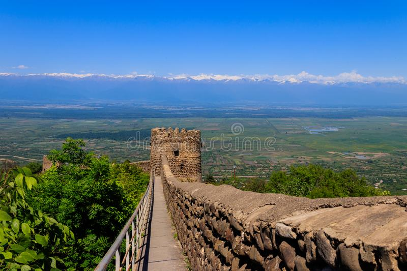 View on Alazani valley and tower of old city wall in city Sighnaghi. Kakheti, Georgia stock photo