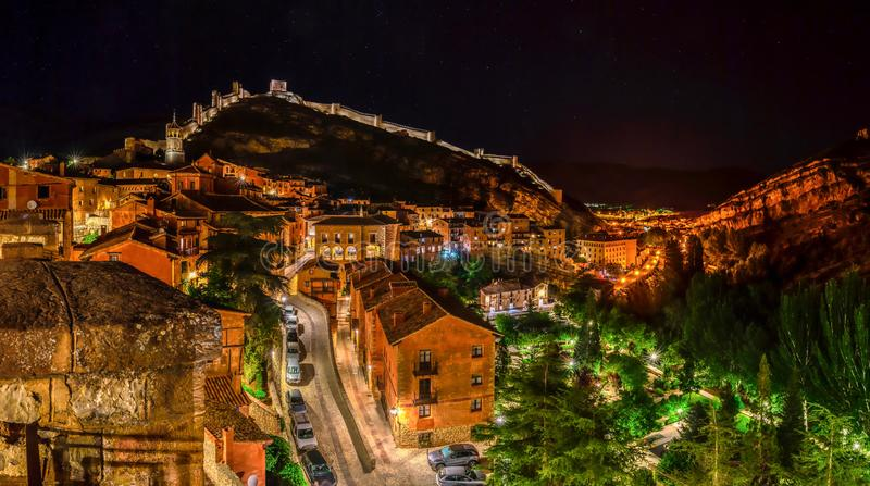 Beautiful fairy tale village at night. View of Albarracin the most beautiful  village in Spain at night with colorful lights and bright houses in Aragon, Spain stock image