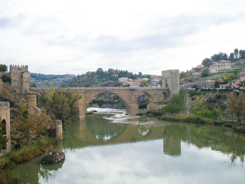 View of the Alcantara Bridge. The bridge of Alcantarais a Roman arch bridge in Toledo, Spain, spanning the Tagus River stock photos