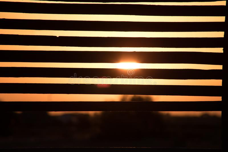 View from alcove on orange sunset sky. Seaside tropics. Selective focus. Beach side concept stock photos