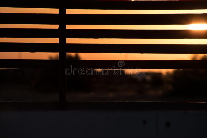 View from alcove on orange sunset sky. Seaside tropics. Selective focus. Beach side concept royalty free stock image