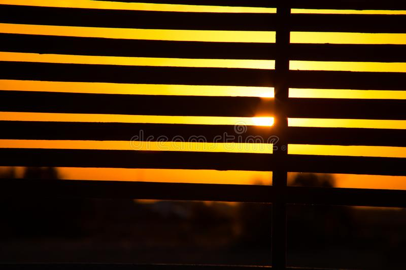 View from alcove on orange sunset sky. Seaside tropics. Selective focus. Beach side concept royalty free stock photography