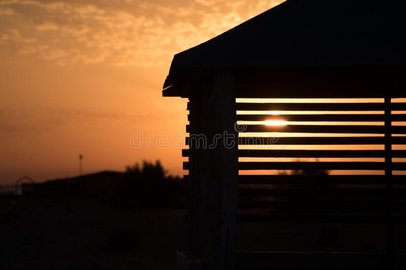 View from alcove on orange sunset sky. Seaside tropics. Selective focus. Beach side concept royalty free stock images