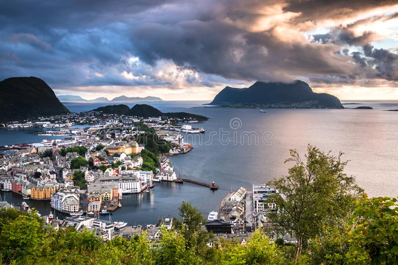 View of Alesund Center and Ocean at Dramatic Sunset. Image of Alesund at dramatic sunset in Summer taken from Mount Aksla Viewpoint. Alesund is a port town on royalty free stock photography