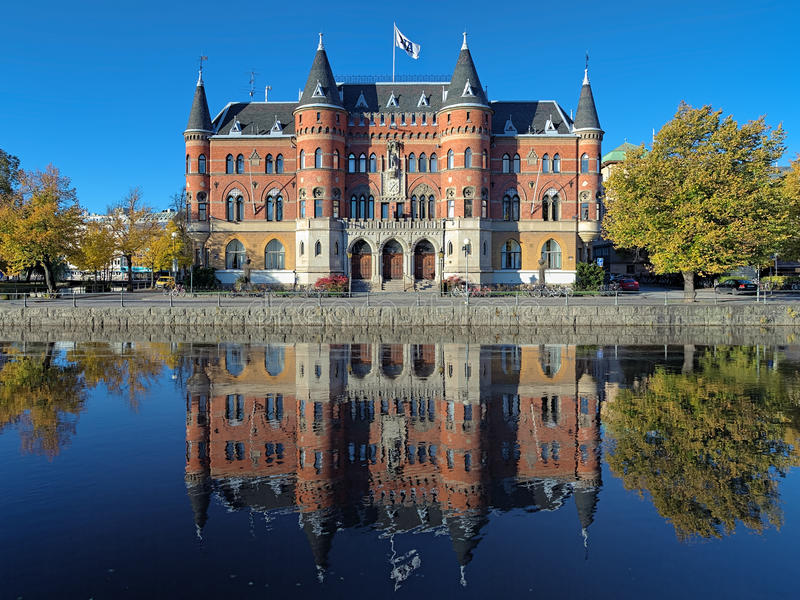 View on Allehandaborgen from Svartan river in Orebro, Sweden. The building originally built in 1891 for Orebro Sparbank and since 1934 it is the office of the stock photography