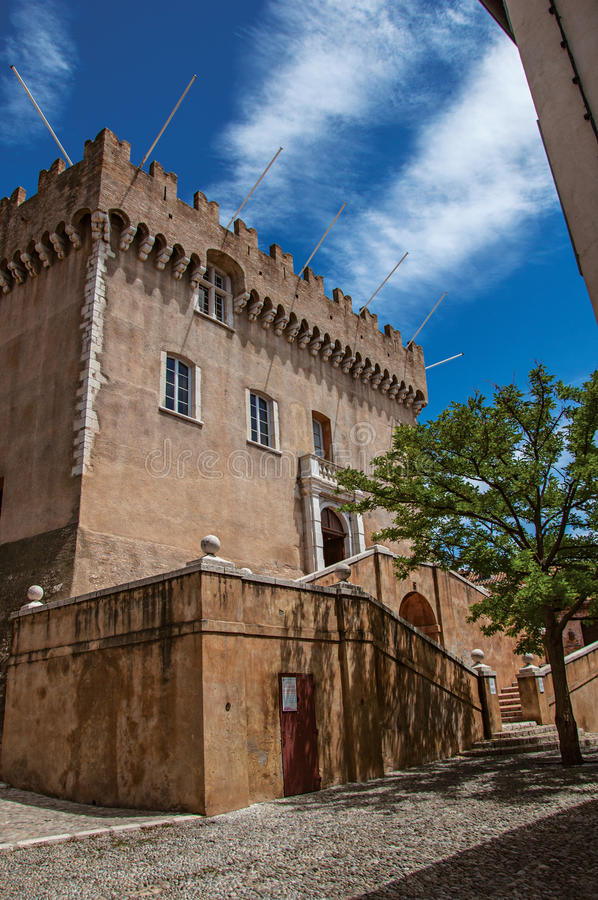 View of alley with trees and facade of the Grimaldi Castle in Haut-de-Cagnes. stock photo