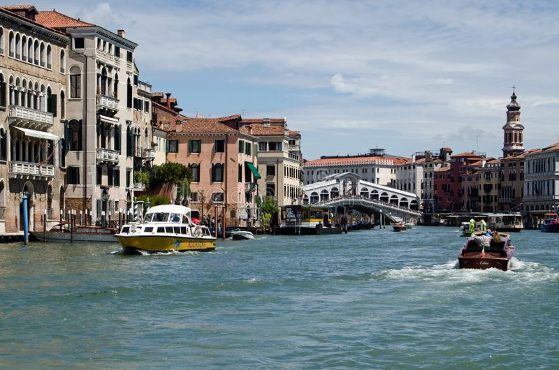View along Grand Canal, Venice looking towards Rialto Bridge on a Sunny Spring morning stock image