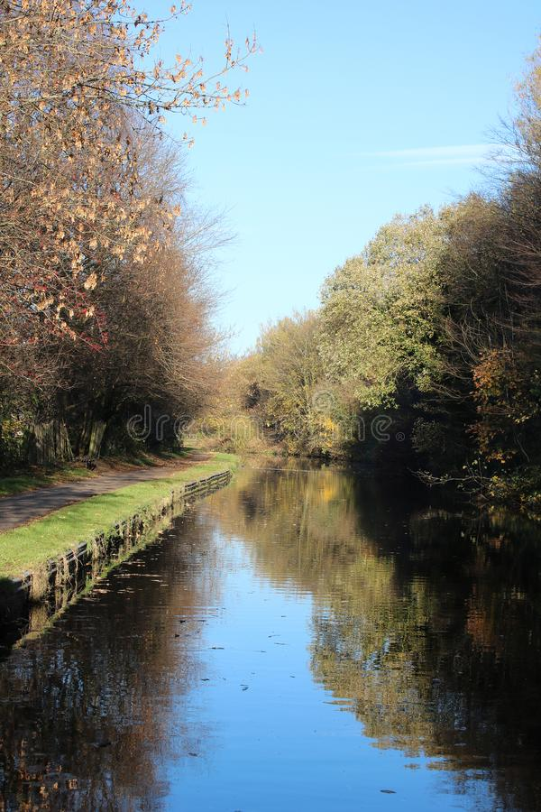 Lancaster canal and towpath, Lancaster, Lancashire, UK. View along the Lancaster Canal and towpath in a rural looking area with no buildings near the freehold stock image