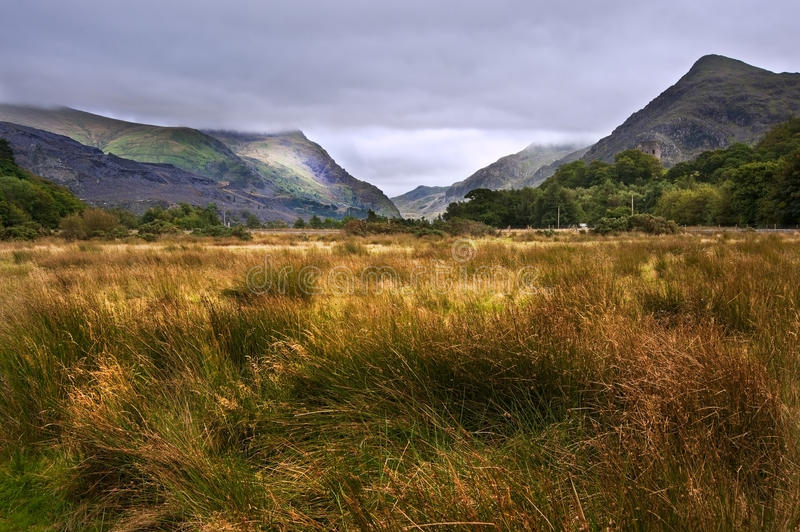 View along Llanberis Pass towards Snowdon. View along Llanberis Pass towards Glyder Fawr on left and Snowdon on right on cloudy overcast day royalty free stock photo