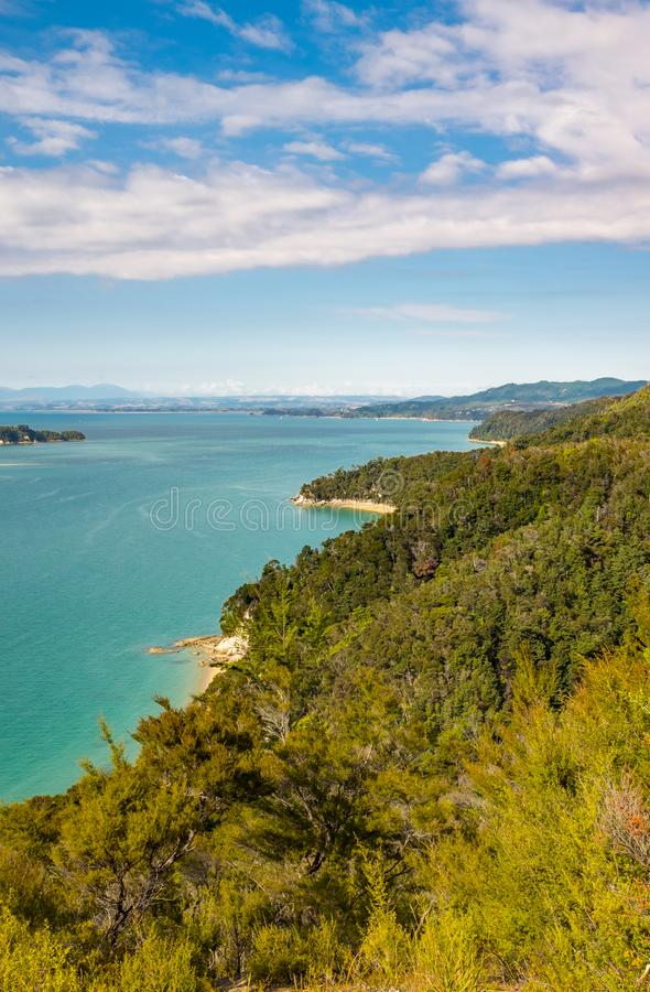 A view along the many bays and golden beaches at the incredibly beautiful Able Tasman National Park, South Island, New Zealand. Nobody in the image stock images