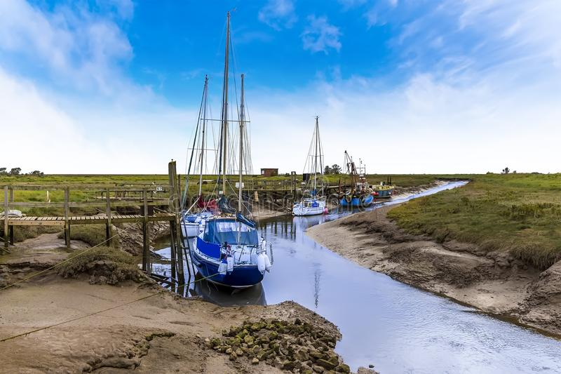A view along a muddy creek looking out to sea at Gibraltar Point near Skegness, UK royalty free stock photos