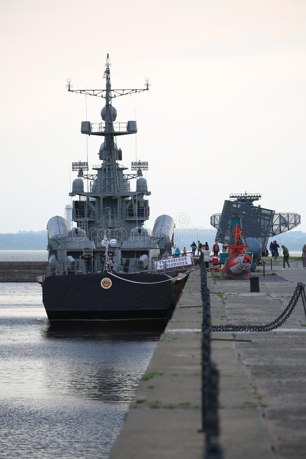 View along the Petrovsky canal on the moored corvette in the evening. The Russian Navy. The large missile corvette R-47 Tambovsky Komsomolets. The Baltic Fleet royalty free stock photography