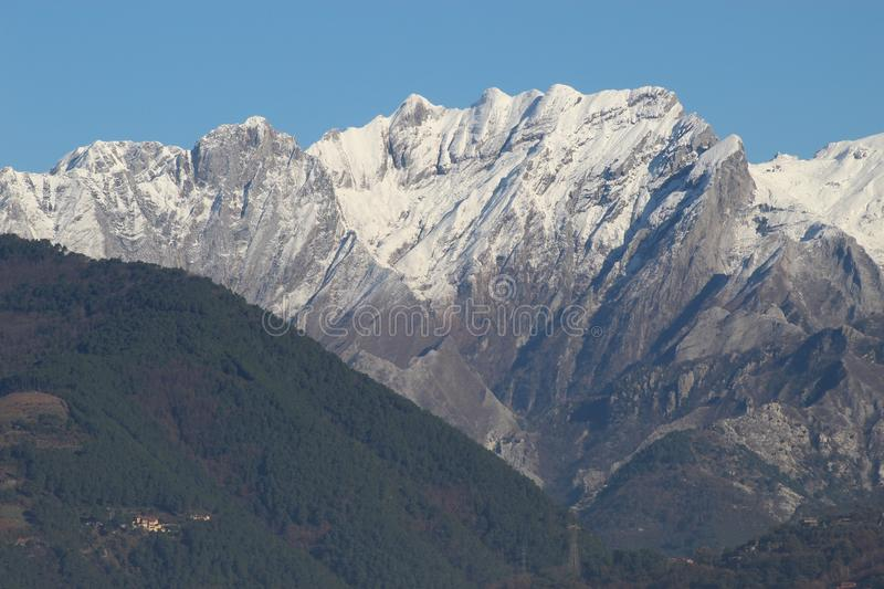 The snow on the beautiful mountains. This is the view of the Alps mountains. The snow has fallen on the mountains since a few days. This picture was taken at the royalty free stock photo