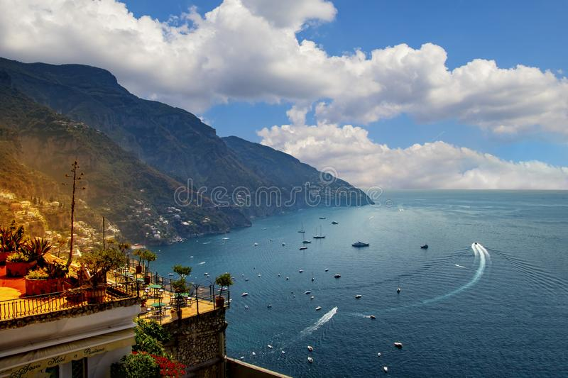 The view of Amalfi coast. This is on the south of Italy in Europe. The city stands on cliffs above the sea. There are boats on the royalty free stock image