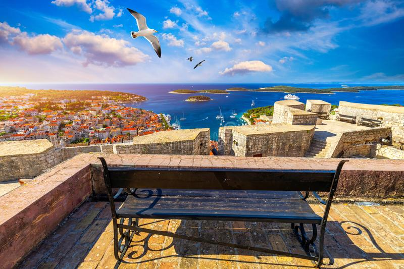View at amazing archipelago in front of town Hvar, Croatia with seagull`s flying over the city. Harbor of old Adriatic island tow royalty free stock photo