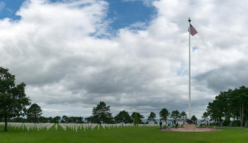 View of the American Cemetery at Omaha Beach in Normandy with US flag stock photos