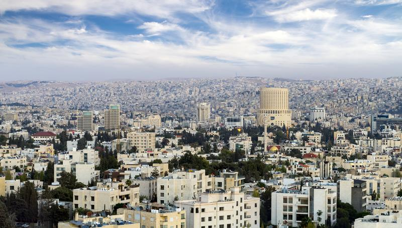 The view of Amman city from air - view of modern buildings in Amman the capital of Jordan. The view of Amman city from air - view of modern buildings in Amman royalty free stock images