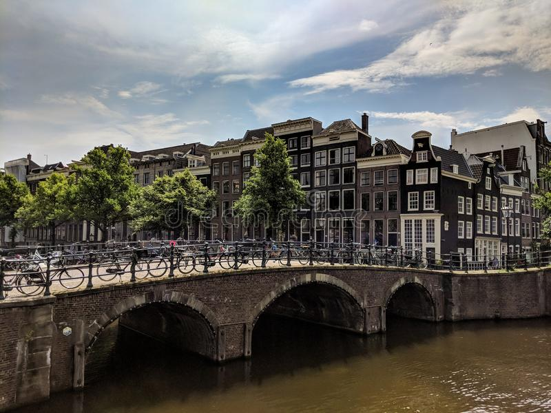 View of Amsterdam canals with bridge and typical dutch houses. Holland royalty free stock photo