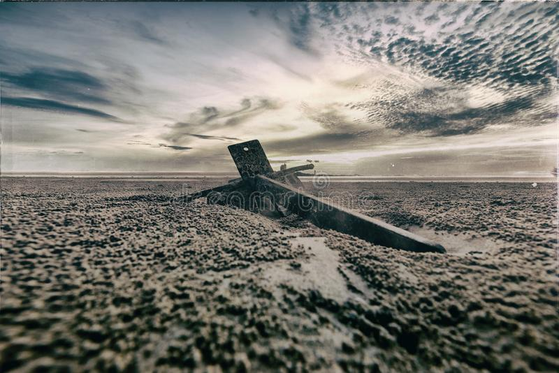 The view of the anchor on the sand royalty free stock photography