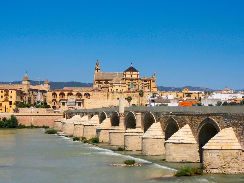 View at ancient Cathedral and roman bridge across Guadalquivir river in Cordoba royalty free stock photos