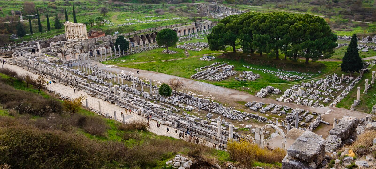 View of the ancient city from the top of the Ephesus Theater, Celsus Library, Columnar road and Agora. The ancient city is listed. As a UNESCO World Heritage stock photography