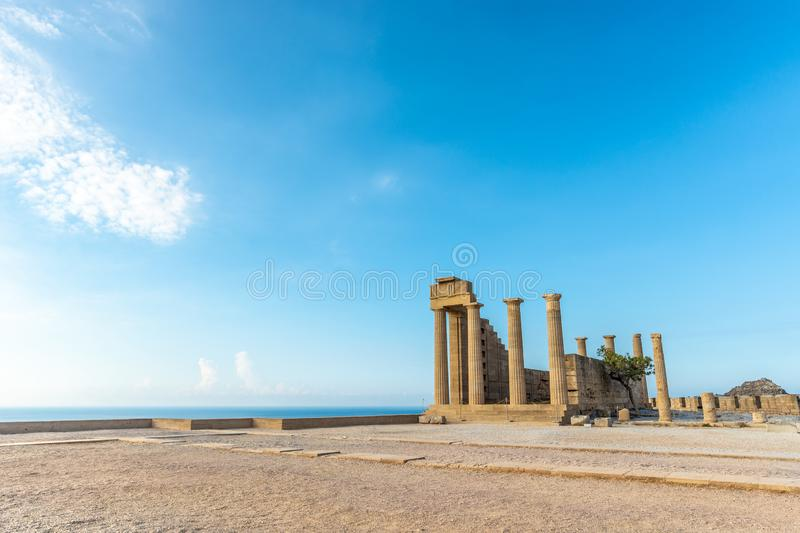 View of an ancient pillars of the acropolis of Lindos. Under beautiful hot summer sky royalty free stock photography