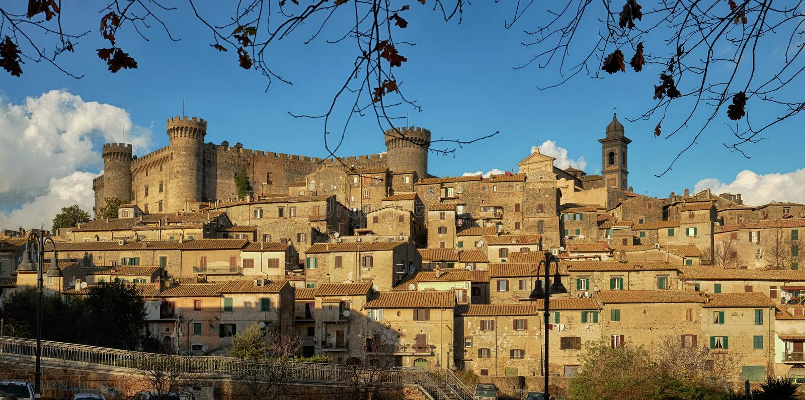 View of the ancient town of Bracciano near Rome, Italy. Ancient town of Bracciano dominated by the medieval castle of the Orsini-Odescalchi family