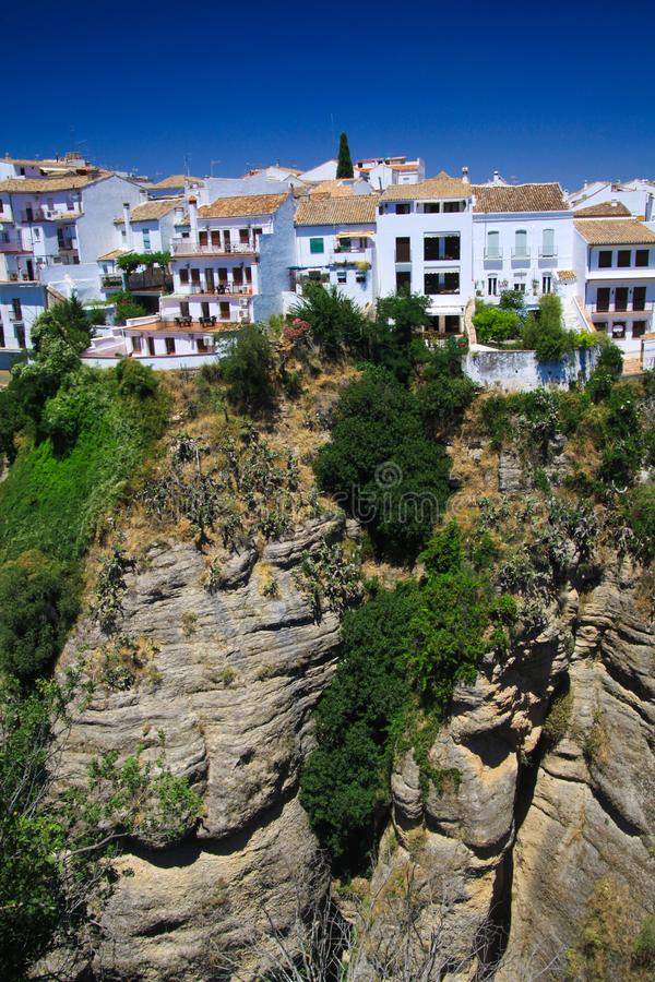 View on ancient village Ronda located precariously close to the edge of a cliff in Andalusia, Spain stock images