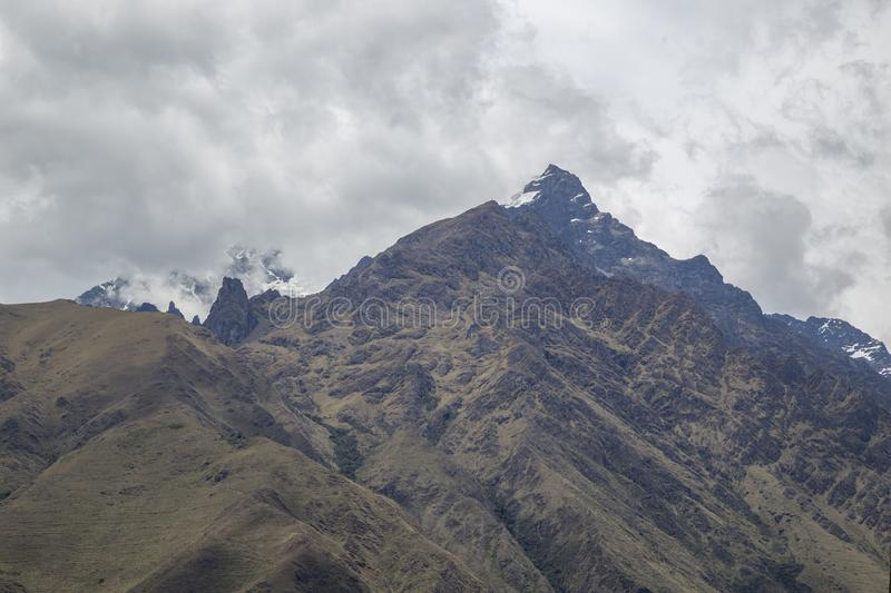 View of the Andean mountain range and the snowy La Veronica in Cusco-PERU. Andes, little, peak, adventurers, cuzco, paths, incas, landscape, shrine, hiking stock photos