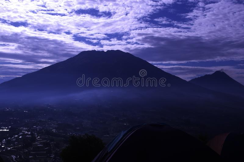 View of Andong Mountain Peak. The view of Merbabu Mountain is seen from the peak of Andong Mountain royalty free stock photos