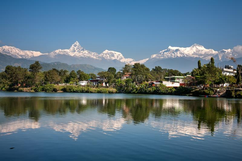 View at Annapurna mountain range and its reflection in Phewa lake in Pokhara, Nepal royalty free stock photography