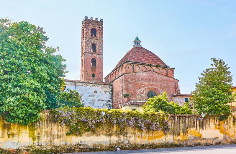 The rear side of St John and Reparata Church in Lucca, Italy. The view from the Antelminelli Sqaure on the back side of Church of Saints John and Reparata with stock image