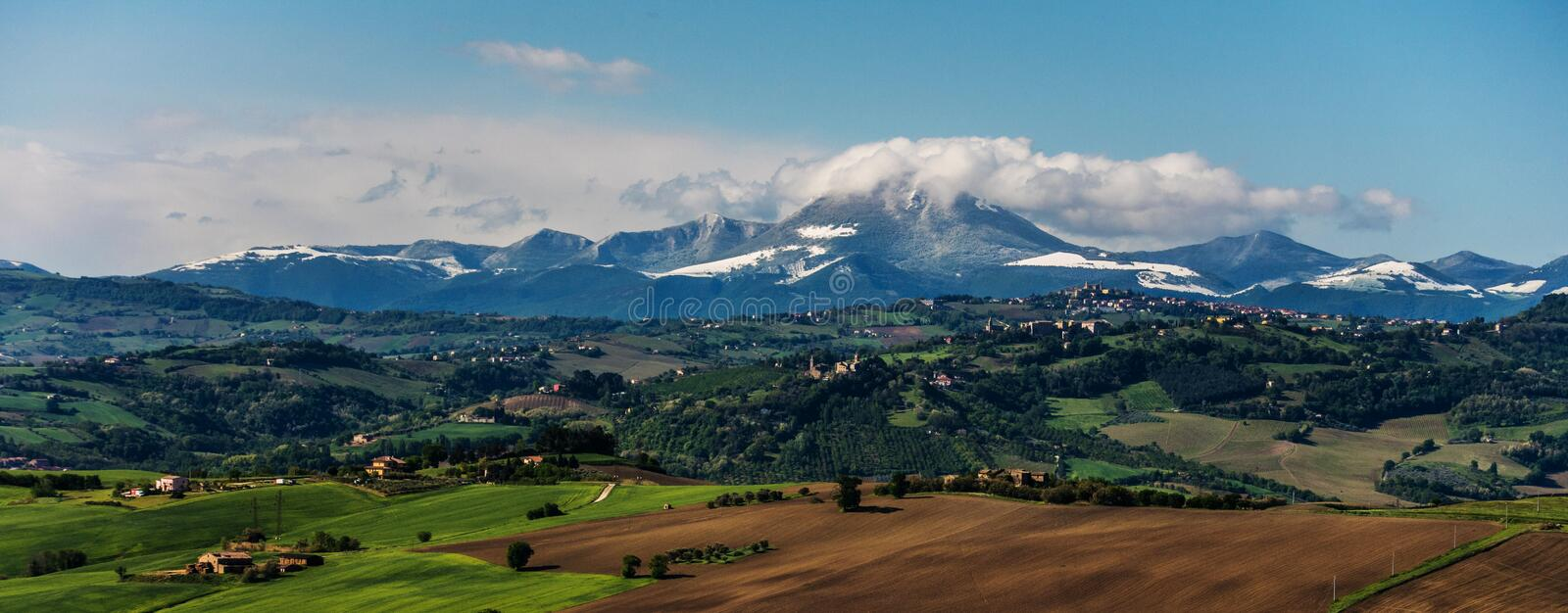 View of the Apennines. Italian hills with Apennines mountains in the background royalty free stock photo