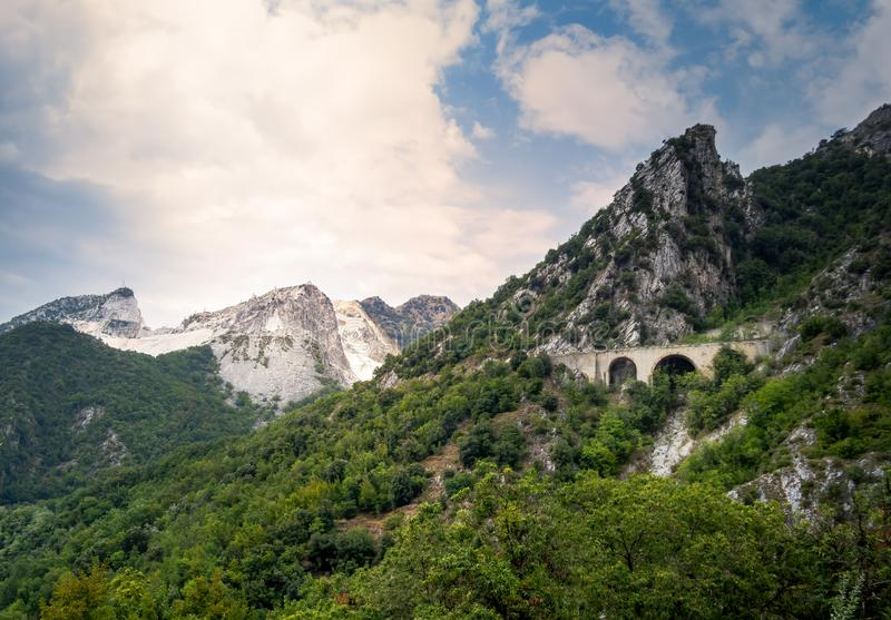View of approach to the marble quarries in the Apuan Alps mountains, near Carrara, Italy. Famous for white marble, but stock images