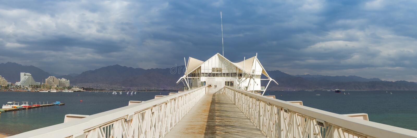 View at the Aqaba Gulf from Eilat, Israel. Eilat is a famous Israeli city with beautiful beaches and resort hotels packed with thousands of vacationers and royalty free stock image