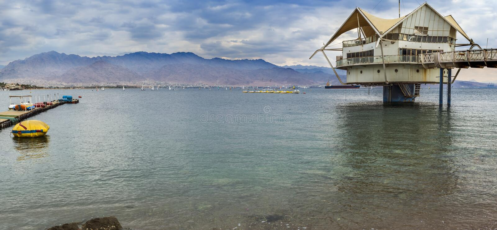 View at the Aqaba Gulf from Eilat, Israel. Eilat is a famous Israeli city with beautiful beaches and resort hotels packed with thousands of vacationers and royalty free stock images