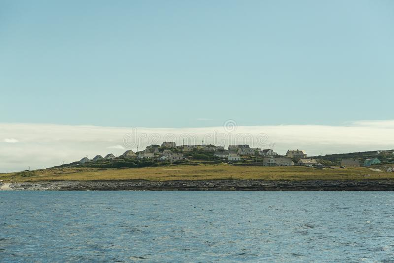 View of the Aran Islands. View of an Aran Island in Ireland from the sea royalty free stock images