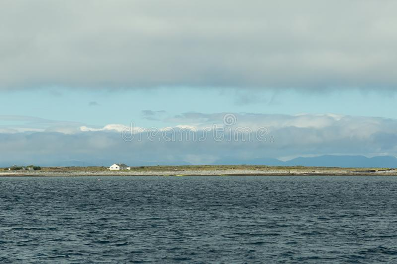 View of the Aran Islands. View of an Aran Island in Ireland from the sea royalty free stock photos
