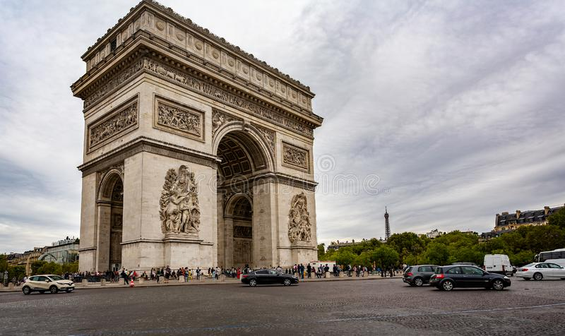 View of the Arc de Triomphe with the Eiffel Tower in the background from the Champs Elysees in Paris royalty free stock image