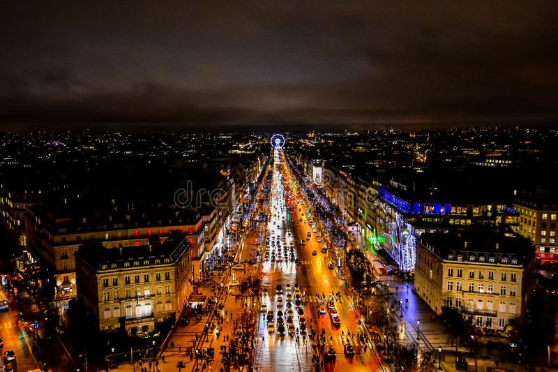 view from Arc de triomphe at night,Photo image a Beautiful panoramic view of Paris Metropolitan City royalty free stock photography