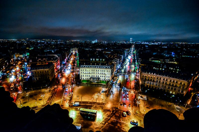 view from Arc de triomphe at night,Photo image a Beautiful panoramic view of Paris Metropolitan City stock photos