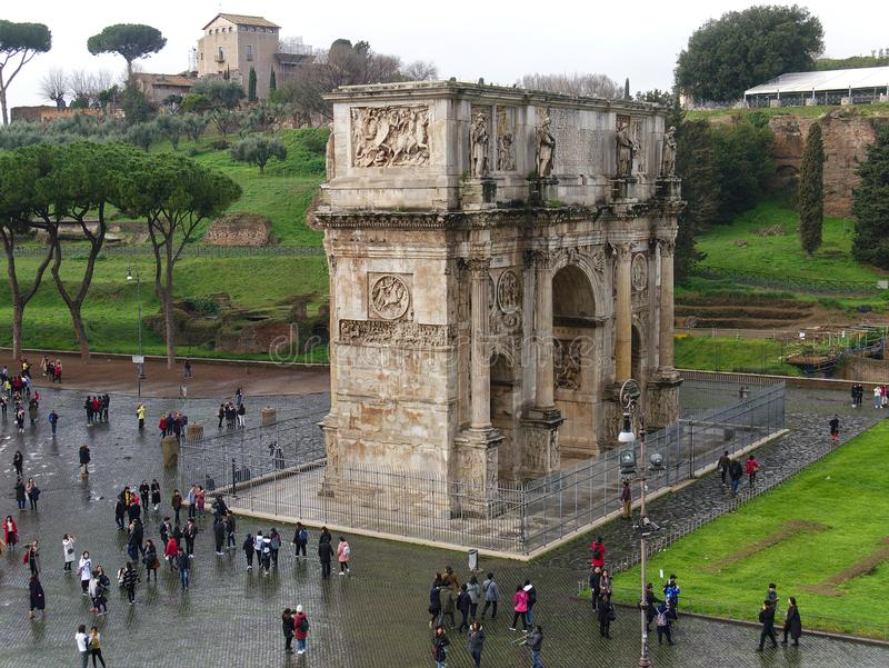 View of the Arch of Constantine in rainy weather in Rome, Italy. Rome, Italy - February 2, 2018: View of the Arch of Constantine in rainy weather from Colosseum royalty free stock photo
